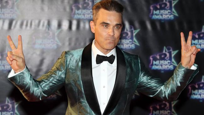 The always entertaining Robbie Williams should be singing for his supper at the ARIAs. Picture: Valery Hache/AFP