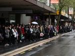 Commuters line up for buses on King William Street. Picture: Calum Robertson