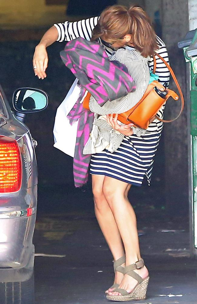 Eva Mendes makes a dash to her car in a bid to escape photographers in Los Angeles.