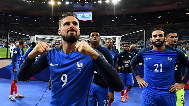 France's forward Olivier Giroud celebrates after winning the FIFA World Cup 2018 qualification football match