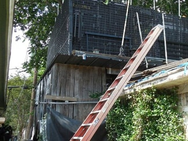 Above the mess ... A man opted to live on his roof for a year rather than clean his house. Picture: KPRC