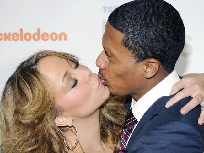 Happier times ... Mariah Carey and husband Nick Cannon show their love in 2009.