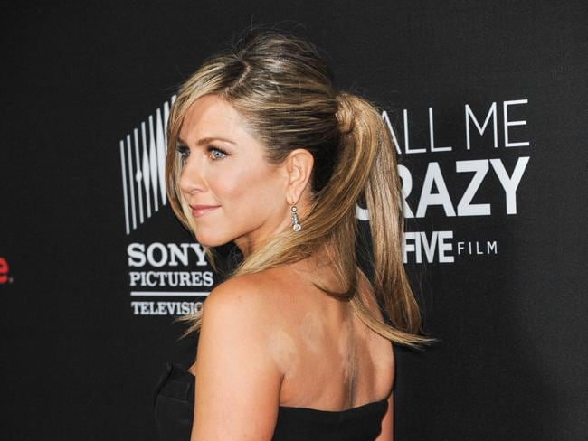 Jennifer Aniston has some badly covered cuppling marks on her shoulders. Picture: Splash News