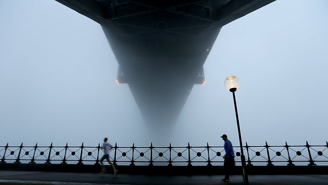 A thick fog has descended on Sydney causing problems.. Picture: John Grainger