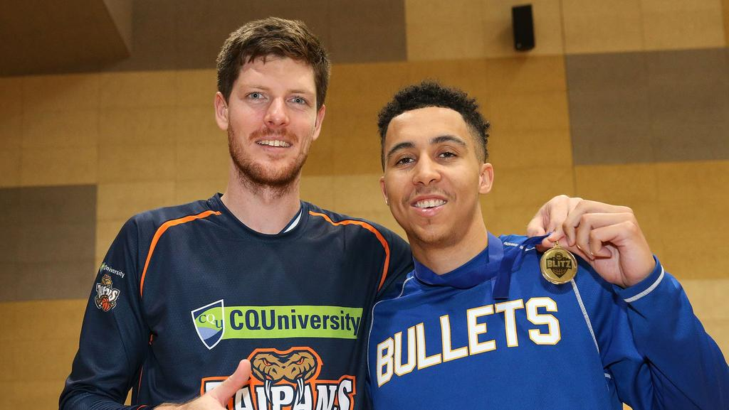 Cameron Gliddon of the Taipans with former teammate Travis Trice.