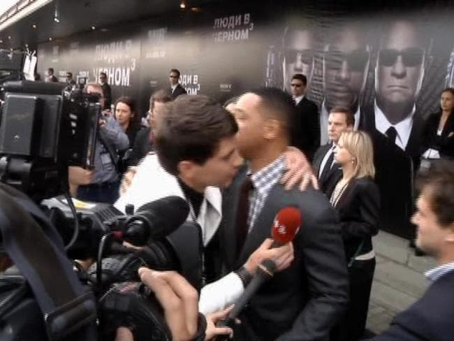 "Repeat offender ... in this video image taken from AP video on May 18, 2012, Will Smith is embraced by reporter Vitalii Sediuk on the red carpet before the premiere of ""Men in Black III"" in Moscow."