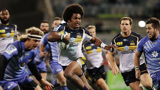 CANBERRA, AUSTRALIA - JULY 11: Henry Speight of the Brumbies runs the ball during the round 19 Super Rugby match between the Brumbies and the Force at Canberra Stadium on July 11, 2014 in Canberra, Australia. (Photo by Stefan Postles/Getty Images)