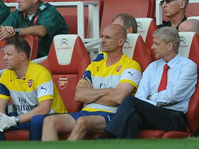 Arsenal's manager Arsene Wenger, right, ponders the match against Benfica.