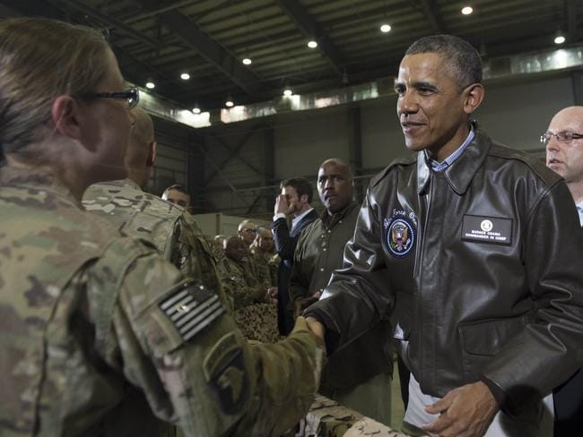 US President Barack Obama greets US troops during a surprise visit to Bagram Air Field. AFP PHOTO/Saul Loeb