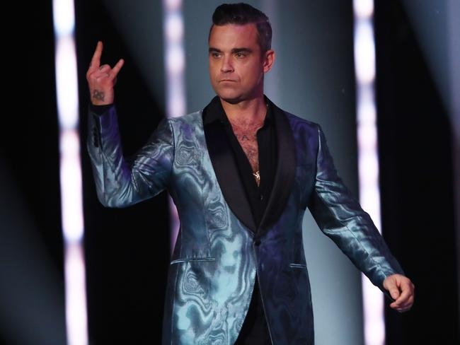 Robbie Williams presents on stage during the 30th Annual ARIA Awards. Picture: Getty