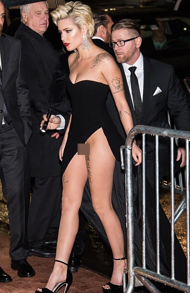 The perils of a thigh-high split and a floor-length train. Picture: Splash News