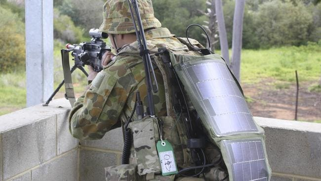 Heavy battery packs replaced ... An Australian soldier wears flexible solar panels instead. Picture: ADF