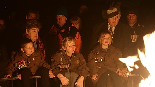 Children pay their respects. Picture: Hamish Blair