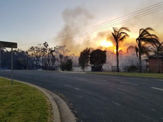 The scene at Tathra as smoke billows into the air.