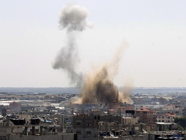 Pommeled ... smoke billows following an Israeli air strike in Rafah, in the southern Gaza Strip.