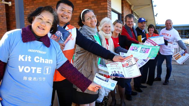 Candidate supporters handing out how-to-vote cards at a pre-poll venue for the Ryde Council election. Picture: Angelo Velardo