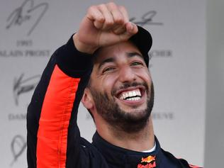 Red Bull's Australian driver Daniel Ricciardo celebrates after winning the Formula One Azerbaijan Grand Prix at the Baku City Circuit in Baku on June 25, 2017. / AFP PHOTO / Andrej ISAKOVIC