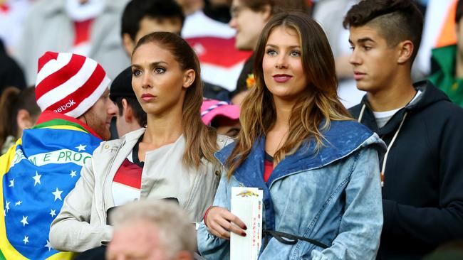 Ann-Kathrin Broemmel (L), girlfriend of Mario Goetze of Germany, and Montana Yorke, girlfriend of Andre Schuerrle of Germany, look on from the crowd.