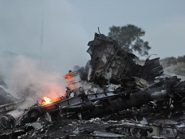 Flames among the wreckage. Picture: AFP / DOMINIQUE FAGET