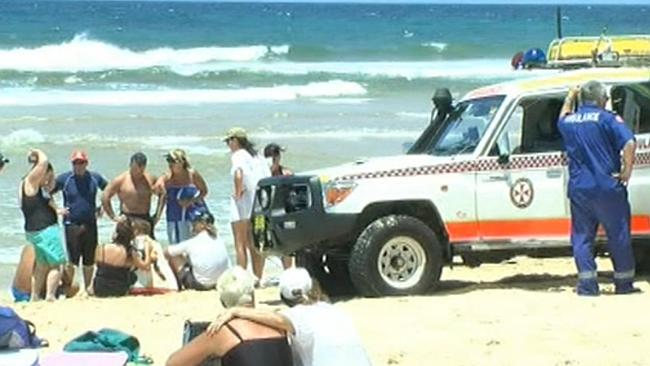 Channel Nine screengrab of the scene shortly after Mr Priestly was pulled from the water