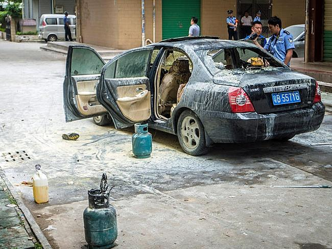 The car after it was blown up in the streets of China.