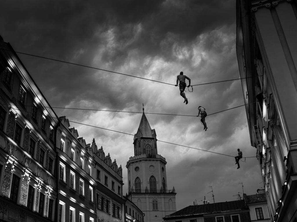 """Three artists are performing slacklining during circus art festival in Lublin/Poland. Dark clouds are prelude of a huge summer storm."" Picture: Kamil Wojtyla, Poland, Shortlist, Open Arts and Culture, 2016 Sony World Photography Awards"