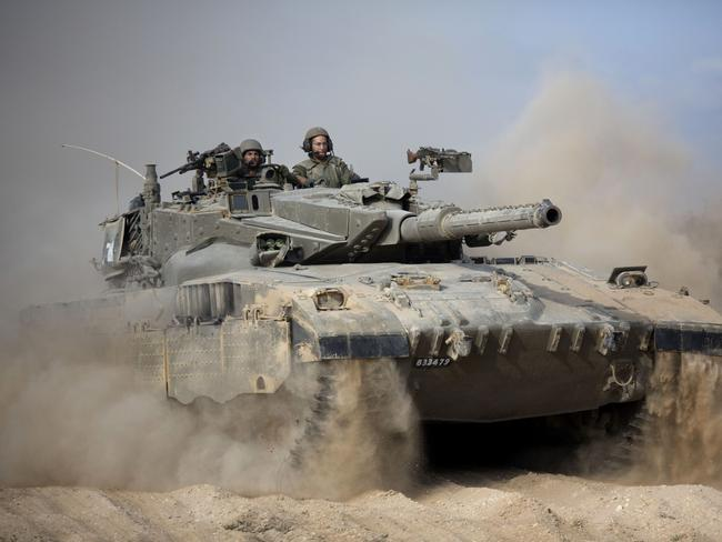 It could get worse ... An Israeli tank moves into position near Israel and Gaza border.
