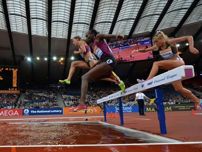 Sweden's Charlotta Fougberg (left), Kenya's Lidya Chepkurui and Australia's Genevieve Lacaze compete in the women's 3000m steeplechase race. Picture: Paul Ellis