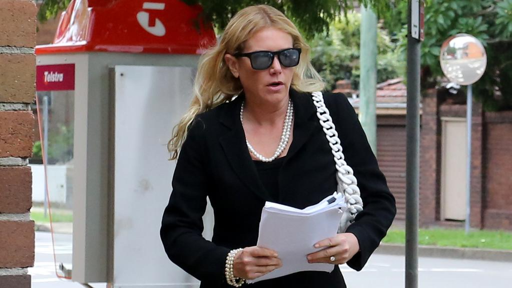 Lizzie Buttrose decked out in diamonds and pearls as she leaves court. Picture: Brianne Makin