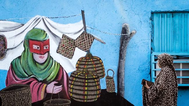 Even the local artwork captures the Bandari's striking masks. Photo: Brook Mitchell