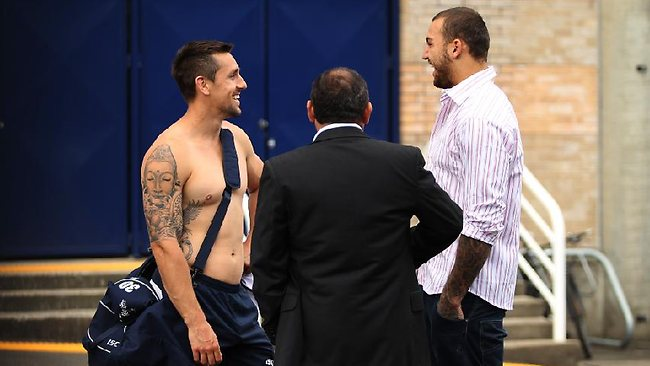 Blake Ferguson and his agent Sam Ayoub chat with Sydney Roosters halfback Mitchell Pearce outside Allianz Stadium yesterday. Picture: Brett Costello