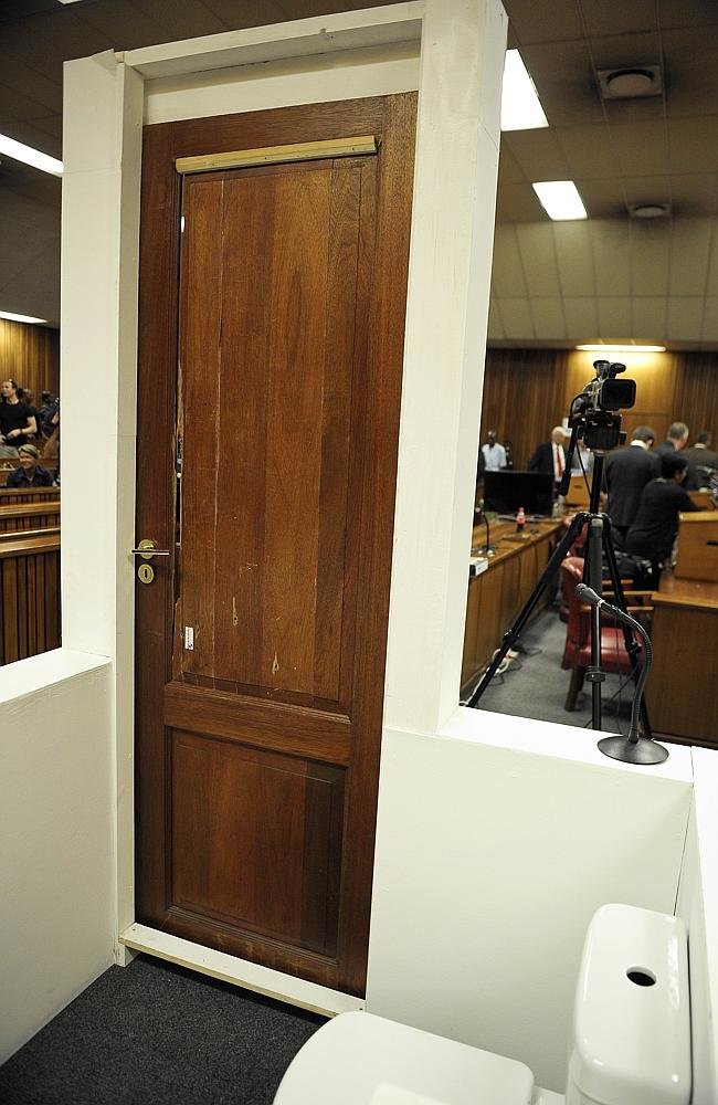Courtroom reconstruction ... the bathroom door which South African Paralympian Oscar Pistorius broke down. Picture: Alexander Joe