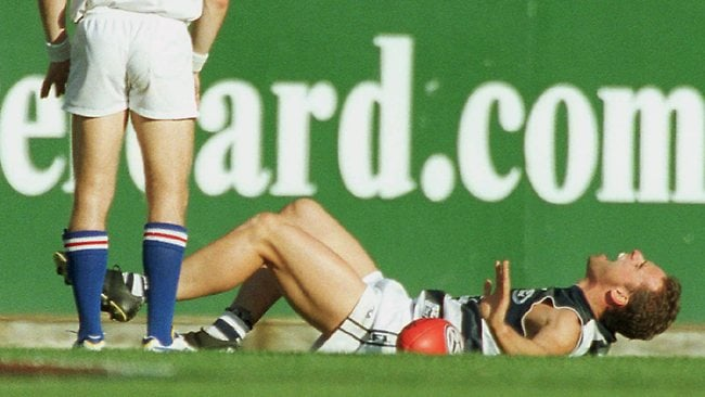 Geelong's Jason Snell injures his ankle in 2001. Picture: Michael Dodge