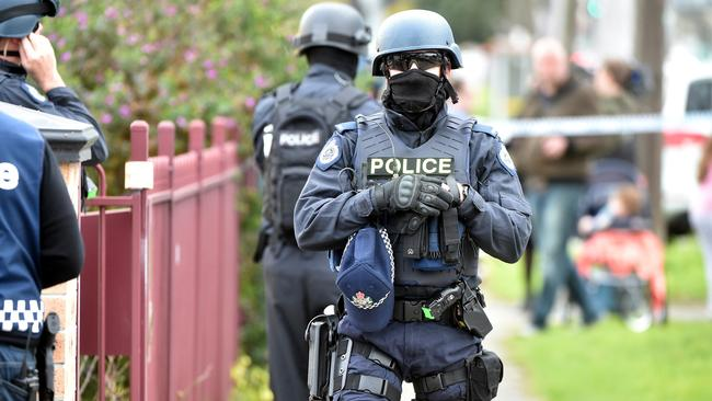 Police outside a house in Braybrook where a raid took place. Picture: Jay Town