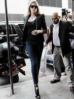<p>Charlize Theron looks every inch the Evil Queen as she steps out in a sharp blazer and killer heels to promote <em>Snow White And The Huntsman.</em> Picture: Snappermedia</p>