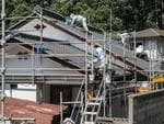 Workers scrub a house to allow residents to move back to their homes Fukushima, Japan. Picture: Arkadiusz Podniesinski/REX Shutterstock /australscope