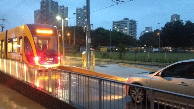 STAND-OFF: The car somehow ended up on the tracks at the tram stop near the croquet fields in Southport