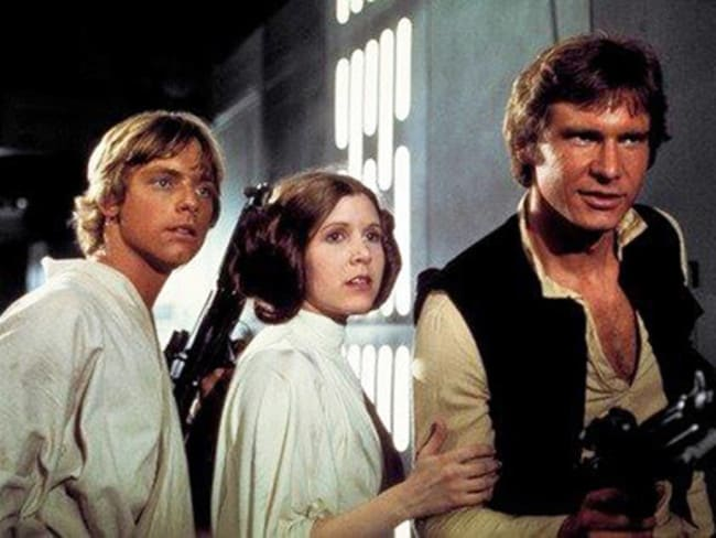 Carrie Fisher alongside her Star Wars co-stars Mark Hamill (left) and Harrison Ford (right) in the original Star Wars movie. Picture: Twentieth Century Fox Home Entertainment via AP