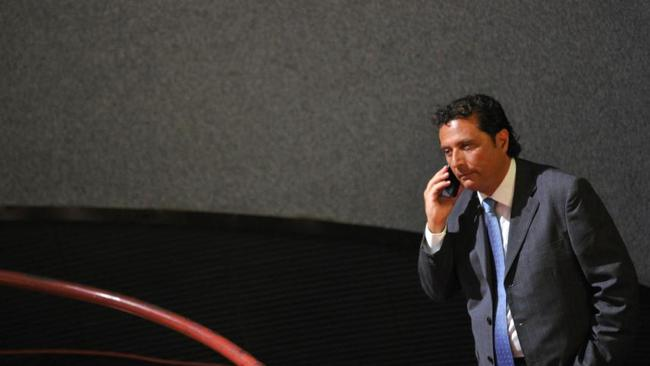 Costa Concordia's captain Francesco Schettino speaks on the phone before his trial on July 17, 2013 in a local theatre in Grosseto. Picture: AFP PHOTO / TIZIANA FABI