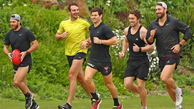 Banned Bombers Travis Colyer, Jobe Watson, Ben Howlett, Heath Hocking and Cale Hooker at training.