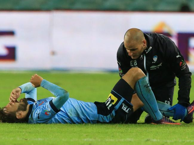 Milos Ninkovic of Sydney FC was injured against Newcastle Jets.