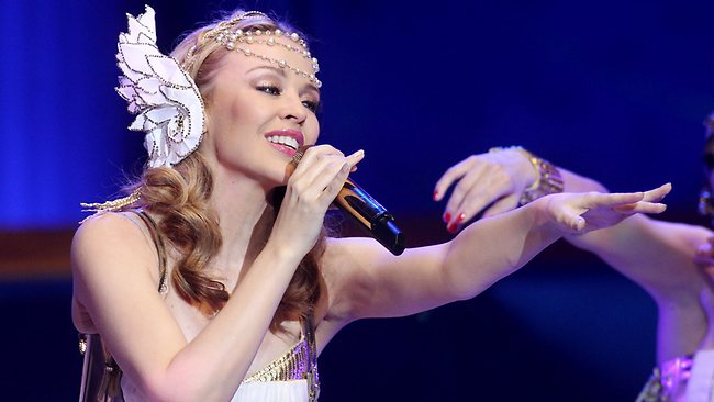 Australian singer Kylie Minogue performs on stage during the German premiere of her 'Aphrodite - Les Folies' tour at the O2 World Arena venue in Hamburg, northern Germany, on February 28, 2011. AFP PHOTO MALTE CHRISTIANS GERMANY OUT