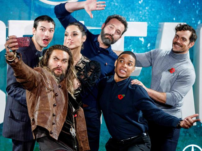 Ezra Miller, Jason Momoa, Gal Gadot, Ben Affleck, Ray Fisher and Henry Cavill pose for a selfie photograph at a photocall for the film Justice League in London. Picture: Tolga Akmen/AFP PHOTO