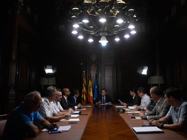 Spanish Prime Minister Mariano Rajo, centre, speaks during a meeting following the attack in Barcelona. Picture: AFP