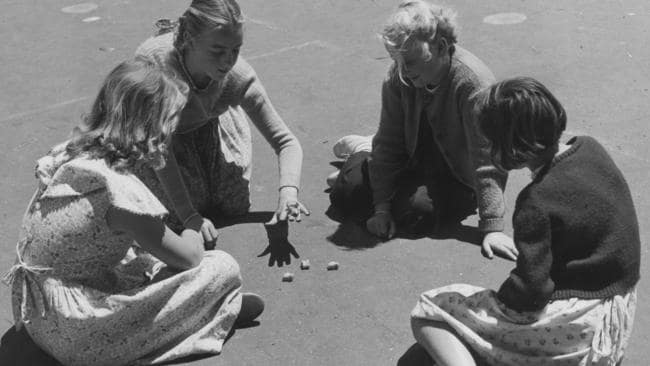 Four girls playing Jacks in Melbourne in 1954.