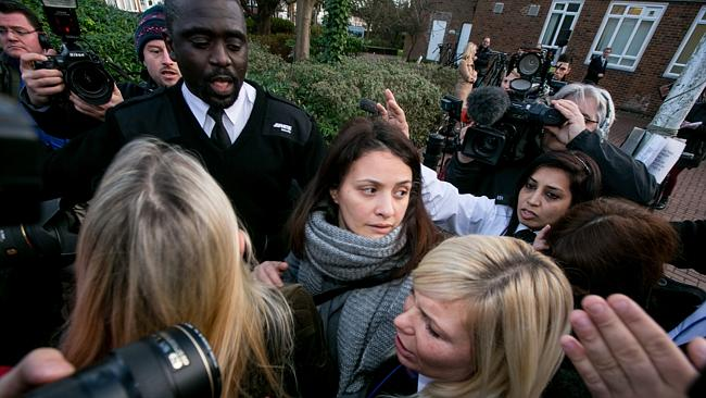 Elisabetta Grillo, centre, and Francesca Grillo (head down, to right) leave Isleworth Crown Court. The Italian sisters, who worked as assistants to Nigella Lawson and Charles Saatchi, were found not guilty of defrauding their former employers. Picture: Dan Dennison/Getty