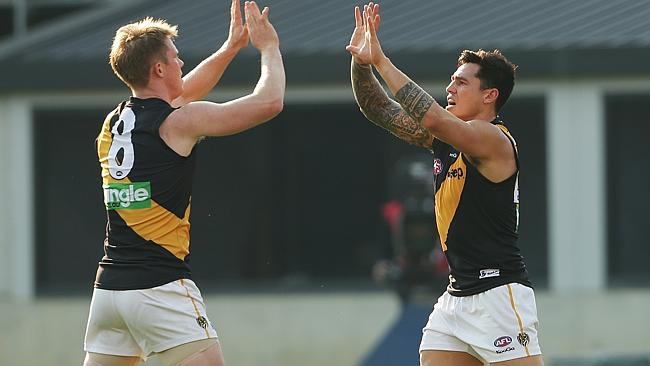Riewoldt celebrates a goal with teammate Aaron Edwards.