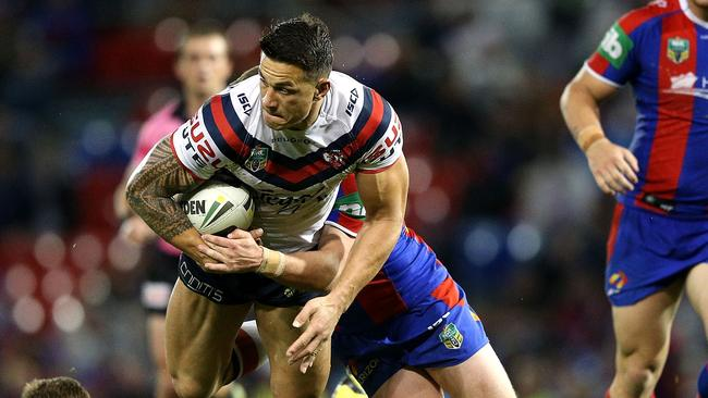 Sonny Bill Williams of the Roosters is tackled.