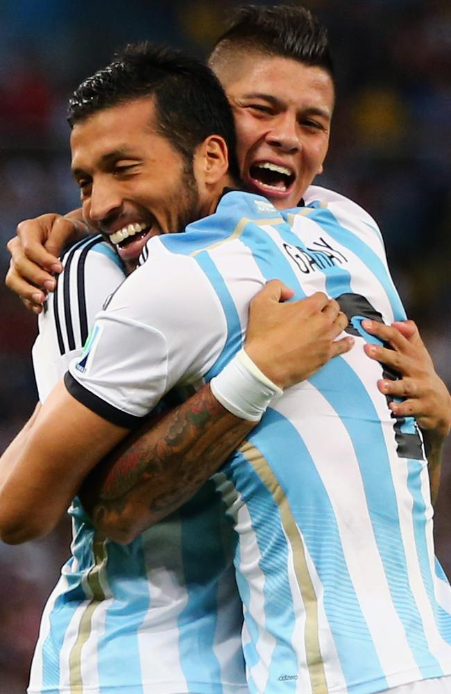 Marcos Rojo and Ezequiel Garay celebrate Argentina's opening goal against Bosnia-Herzegovina.