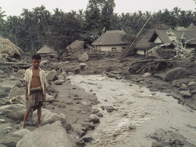 Destruction of neighbouring villages from the eruption of Agung volcano in Bali is seen here, March 26, 1963.
